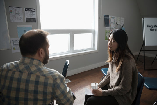 Man and woman talking at support group in community center