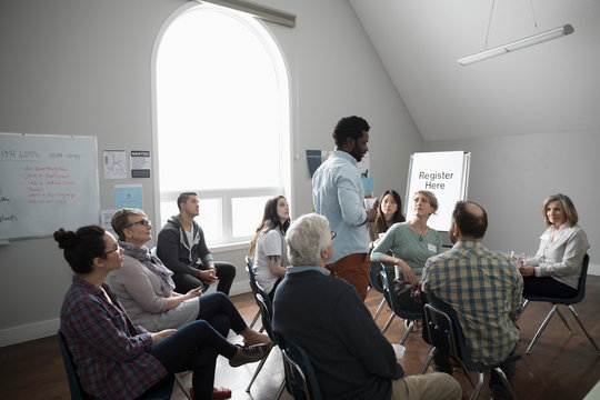Man talking at support group in community center