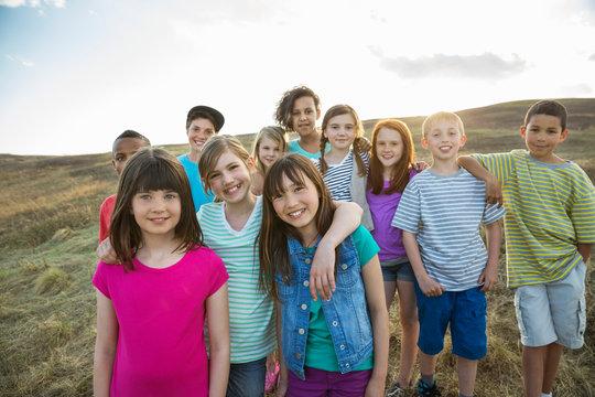 Portrait of cheerful schoolchildren on field trip