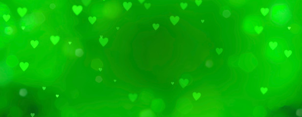 Abstract green background with bokeh in heart shape - St. Patricks Day and love concept