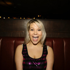 Portrait confident, enthusiastic, playful female millennial in nightclub