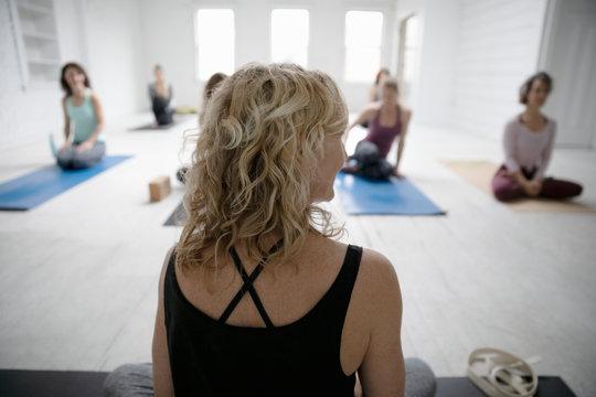 Yoga instructor leading yoga class