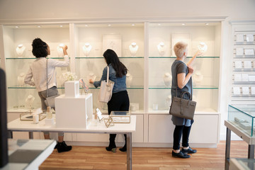Young women shopping in jewelry boutique
