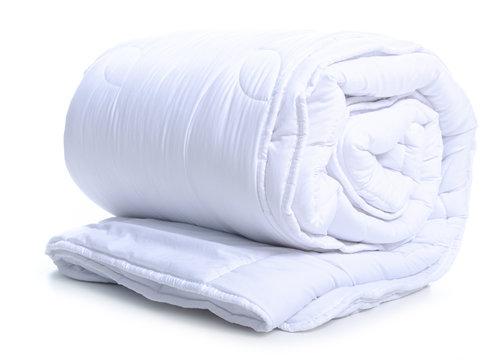 Folded white soft warm blanket on white background isolation