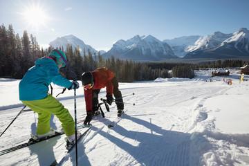 Girl receiving ski lesson from ski resort instructor