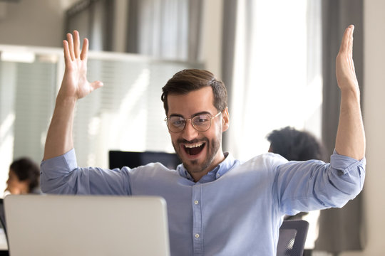 Excited male scream yes winning lottery online