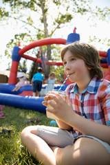 Boy drinking lemonade in park