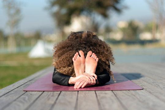 woman doing yoga exercise away from city life - Seated Forward Bend - PASCHIMOTTANASANA