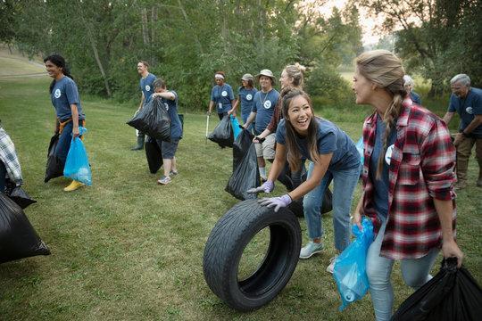 People volunteering, cleaning up garbage in park