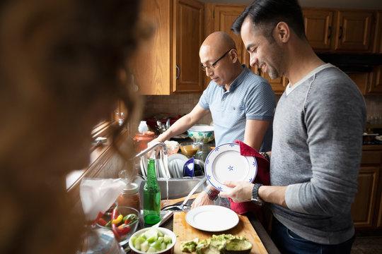 Latinx men doing dishes in kitchen