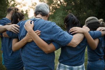 Volunteers hugging in huddle