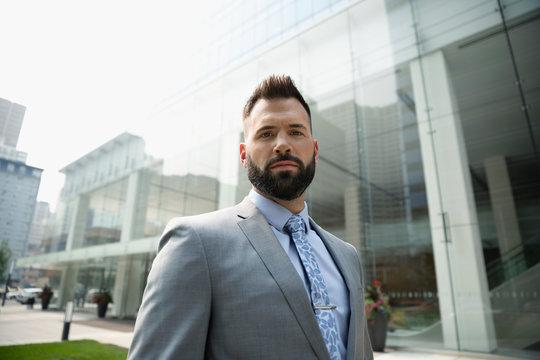 Portrait confident, determined businessman outside urban office building