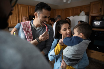 Latinx family cooking in kitchen