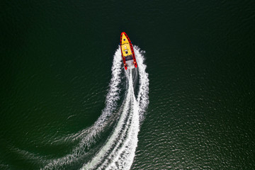 Top down view on speed movement of rescue motorboat.
