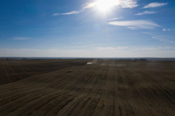 Sun shining over rural farmland landscape