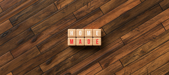 """cube with text """"HOMEMADE"""" on wooden background"""