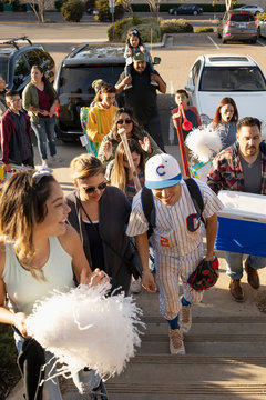 Baseball player and family arriving for game