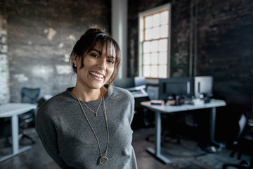 Portrait smiling, enthusiastic creative businesswoman in office Wall mural