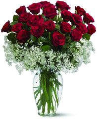 A bouquet of red roses in a clear glass vase on a white background for Valentine's Day and love.