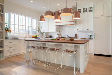 White home showcase interior kitchen with copper pendant lights