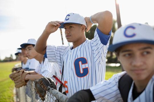 Determined baseball player adjusting hat
