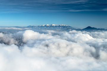 Foto op Plexiglas Blauwe jeans Clouds, winter mountains. Blue sky. High Quality Photo