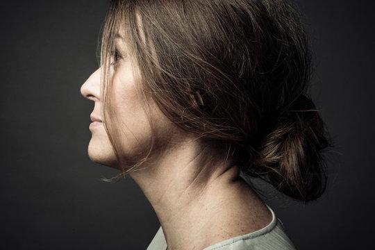 Profile portrait thoughtful beautiful woman looking away