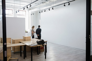 Gallery owners preparing space for exhibition