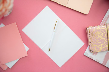 Pen and stationery on pink background