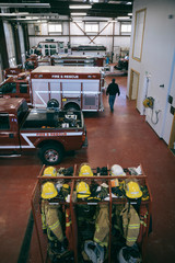 Fire protection suits and fire engines and trucks in fire station