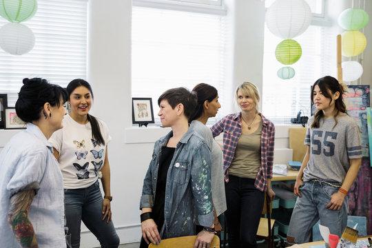 Women talking, socializing in art class