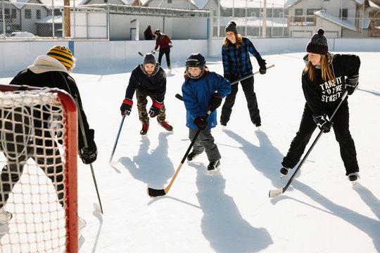 Community playing outdoor ice hockey