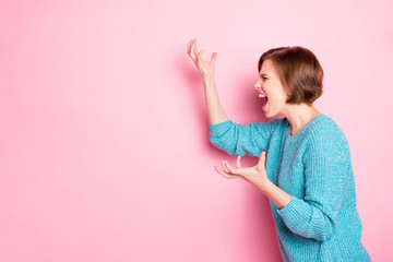 Side profile photo portrait of angry aggressive girl gesturing hands screaming acting isolated pink copyspace background