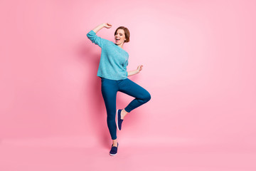 Full length body size view of her she nice attractive lovely funky cheerful cheery brown-haired woman having fun dancing carefree lifestyle isolated over pink pastel color background Wall mural