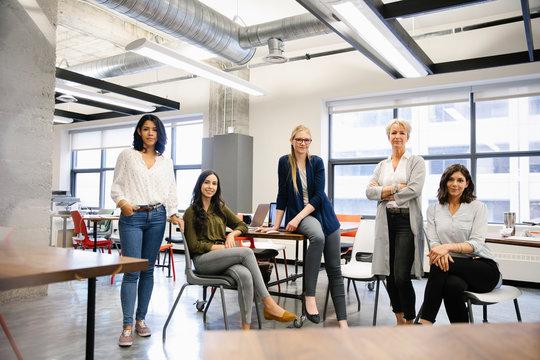 Portrait confident businesswomen in open plan office
