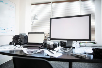 Computers and photography equipment on desk