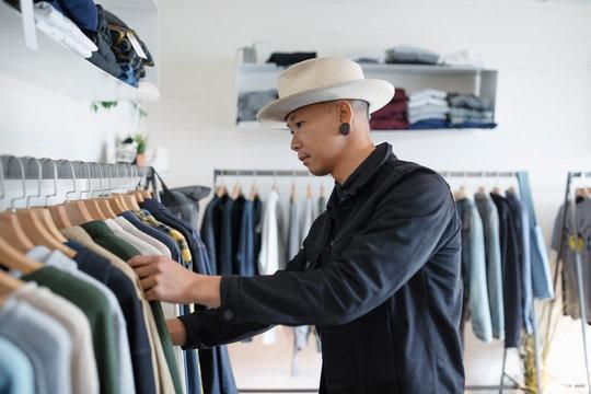 Stylish man shopping in menswear clothing shop