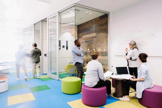 Creative business people brainstorming in open plan office