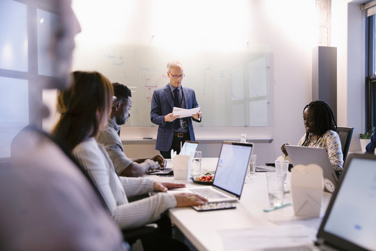 Businessman leading conference room meeting