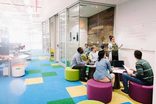 Compute programmers meeting in creative open plan office