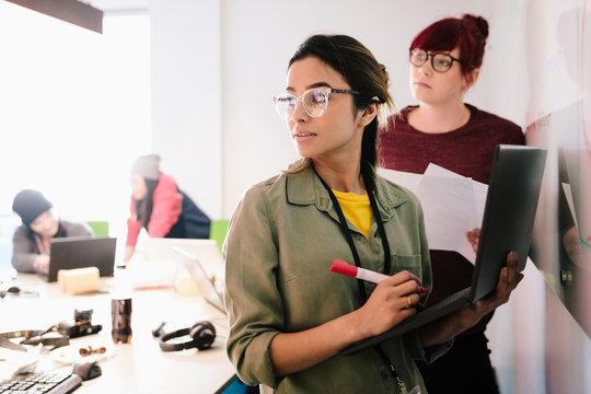 Creative businesswomen brainstorming in conference room meeting