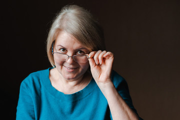 Portrait elderly beautiful woman retired glasses background house