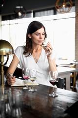 Woman wine tasting in wine bar