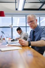 Focused businessman working in coworking space