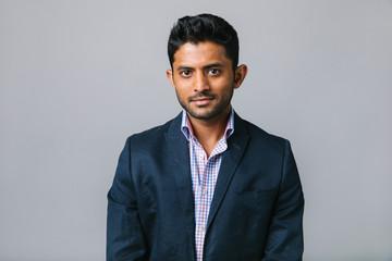Portrait confident, ambitious businessman