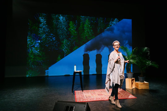 Female inspirational climate change speaker on stage