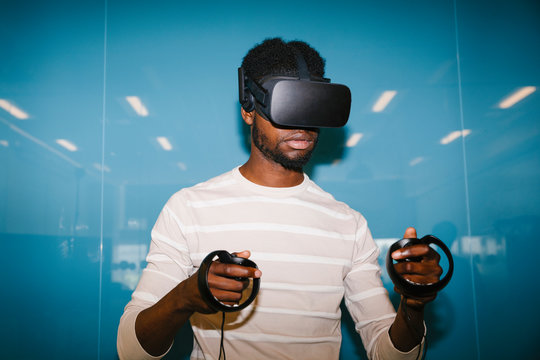 Student wearing VR headset and holding controls