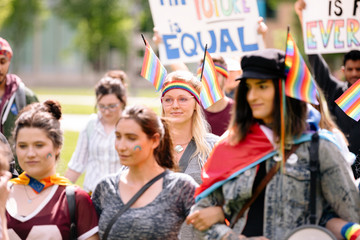 Students marching with banners at gay pride parade