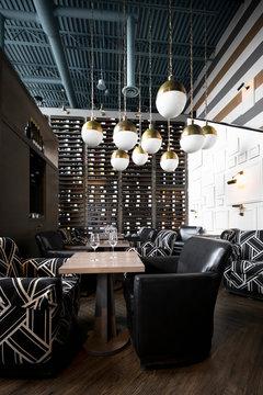 Modern pendant lights hanging above empty wine bar