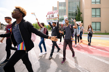 Group of students with banners on gay pride march Wall mural